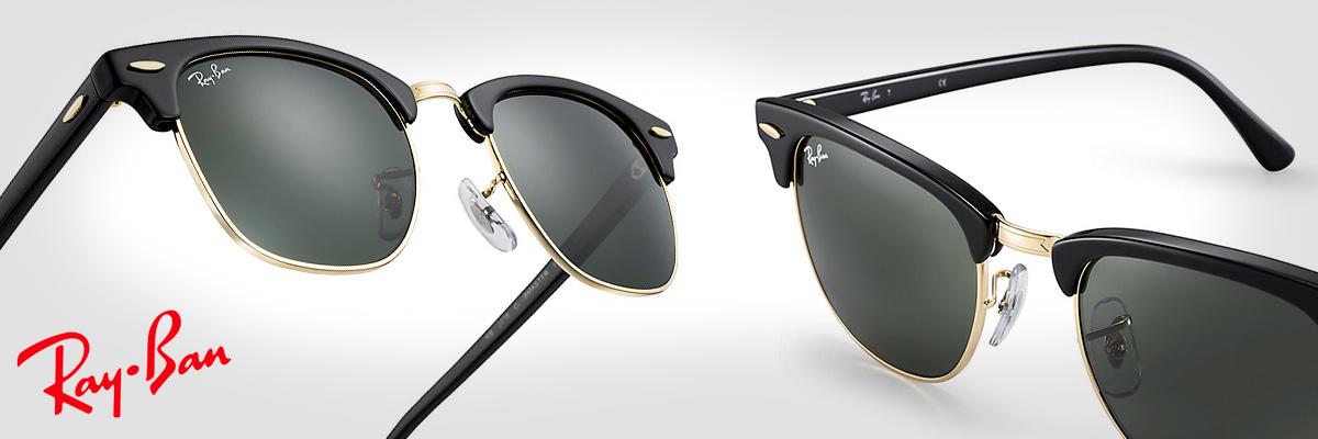 gafas ray ban negras y doradas